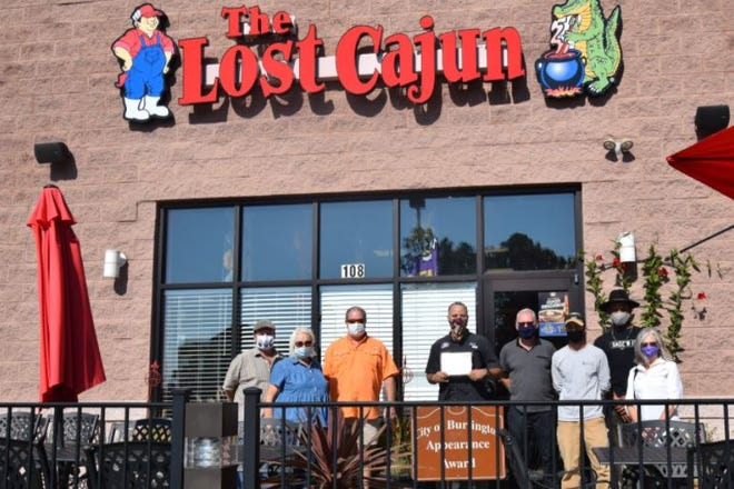 The Lost Cajun, 108 Huffman Mill Road, received the City of Burlington's Community Appearance Award for October. Pictured from left to right are Chuck Beard; Pat Pelt; Paul Taylor; Jacob Coyne, general manager; Jeff Parsons; Jason Barnhill; Roger Moore; and Liz Wells. The City of Burlington Tree and Appearance Commission thanks everyone at The Lost Cajun for all of their hard work to make Burlington a more beautiful place.
