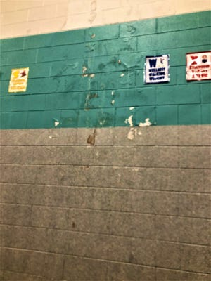 Water running down the exterior wall of Desert Sage's gym is problematic.