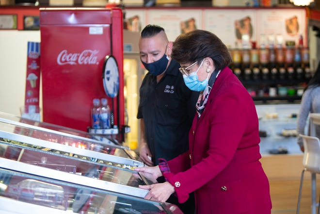 Administrator Jovita Carranza, head of the U.S. Small Business Administration, plays a game of pinball while visiting Bite Me Cake Company, as owner Nick Padilla watches. [CHIEFTAIN PHOTO/ZACHARY ALLEN]