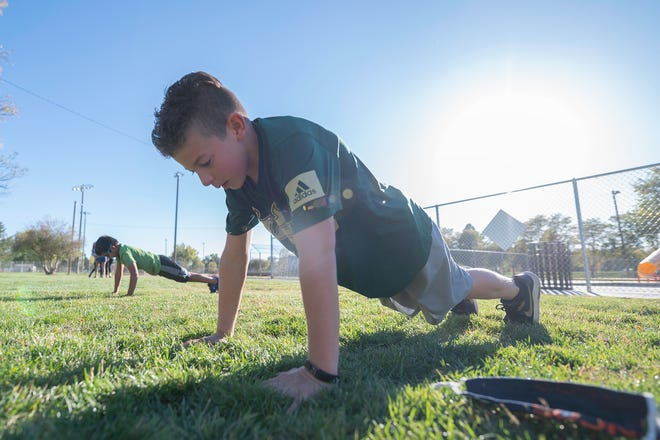 Elias Garcia, 11, does pushups during the Pueblo Swim Club dryland training practice on Tuesday at City Park. [CHIEFTAIN PHOTO/ZACHARY ALLEN]