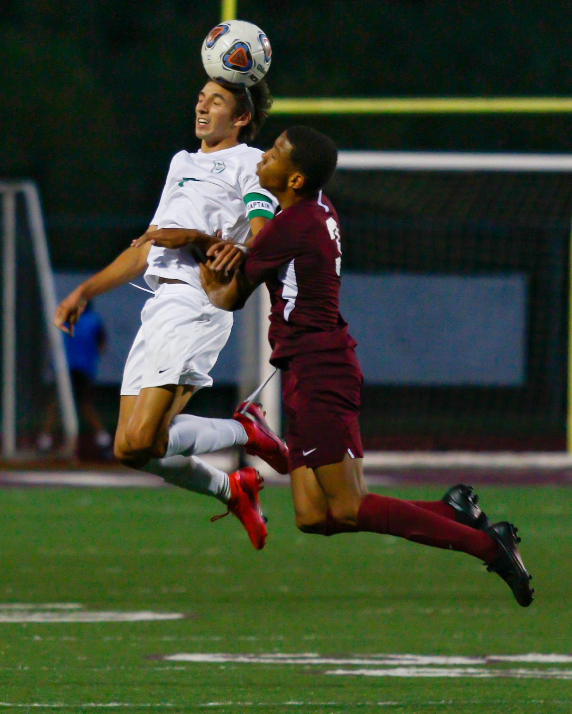 Scioto's Jayden Lunsford (left) heads the ball from Canal Winchester's Kylan Lewis on Sept. 15. Lunsford had a goal in a 2-0 victory over Westerville North on Oct. 13 as the Irish clinched the outright OCC-Capital title at 5-0-2.