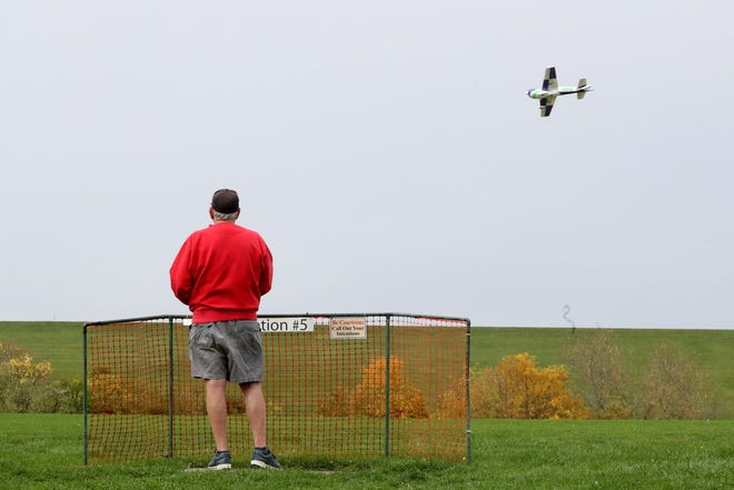 Larry Basford of Gahanna flies his radio-controlled airplane around Dinneen Field in Galena on Oct. 14. The flying field at 5770 Africa Road, near the Alum Creek dam, was leased by the Westerville Model Aeronautics Association in 1987 from the U.S. Army Corps of Engineers. Now the field has a 900-foot grass runway, protective fencing, five concrete-pad flying stations, a frequency-control board and other features. For more informatin go to wmaa-wags.org.