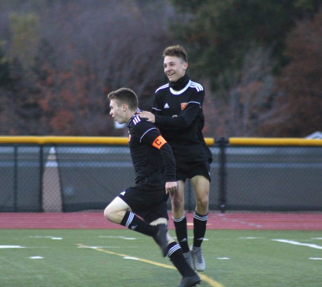 Wellsville's Alex Ordiway, left, and Cody Costello celebrate Ordiway's goal in the first half of Wednesday night's contest against Bolivar-Richburg.
