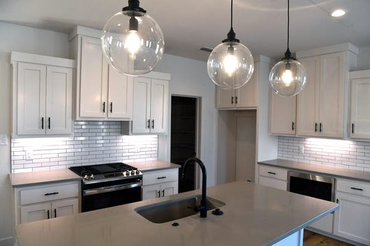 A kitchen in one of the Quarters on Pecan Street development. The kitchen cabinets in the five houses are painted in either light or dark color schemes.