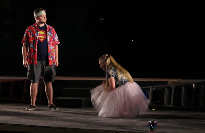 "A disciple (Madi Melbourne) kneels before Jesus (Zane Wilchar) is this rehearsal scene from ""Godspell,"" McMurry University's homecoming musical."