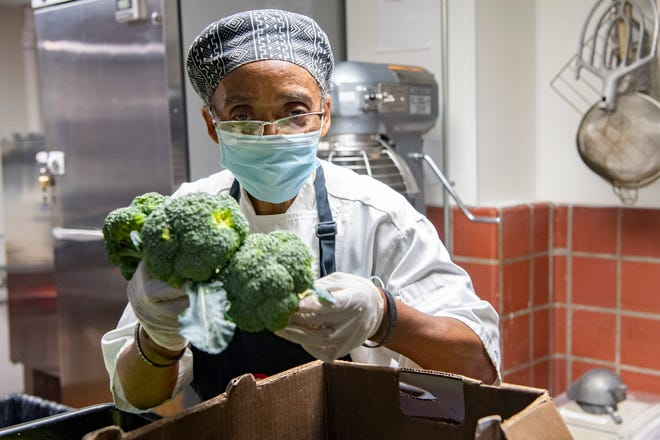 """""""It's a blessing to be able to do this every day,"""" Hanan Shabazz said as she chopped broccoli to prep it for a soup at the Southside Kitchen on Oct. 14, 2020. The staff was feeding about 500 people that day, she said. The Southern Foodways Alliance has awarded Shabazz its annual Ruth Fertel Keeper of the Flame Award for her culinary and community work."""