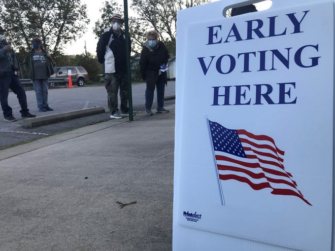 """Voting sites have a """"buffer"""" zone to keep campaigners away from potential voters. Boards of election have to balance free speech rights with laws that protect voters from harassment or intimidation."""