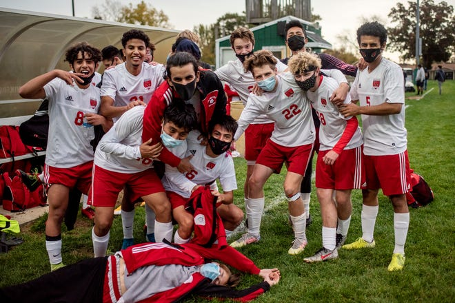 Coldwater varsity boy soccer players celebrate winning the first round of MHSAA boys soccer district tournament on Wednesday, Oct. 14, 2020 at Pennfield High School in Battle Creek, Mich. Coldwater defeated Pennfield 3-0.