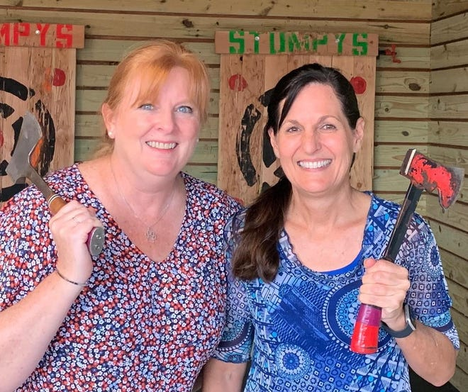 Suzy Fleming Leonard and Sindi Sonnier celebrated 50 years of friendship by whispering secrets late into the night and hurling hatchets and wooden targets.