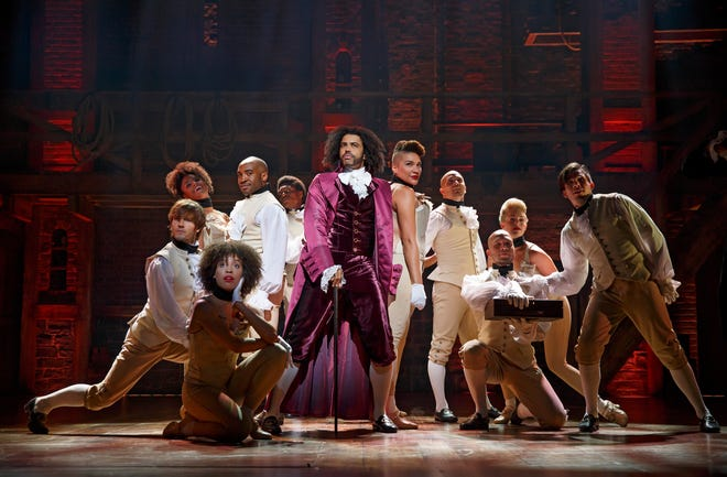 "Daveed Diggs (center) as Thomas Jefferson and the ensemble of the Broadway production of ""Hamilton."""