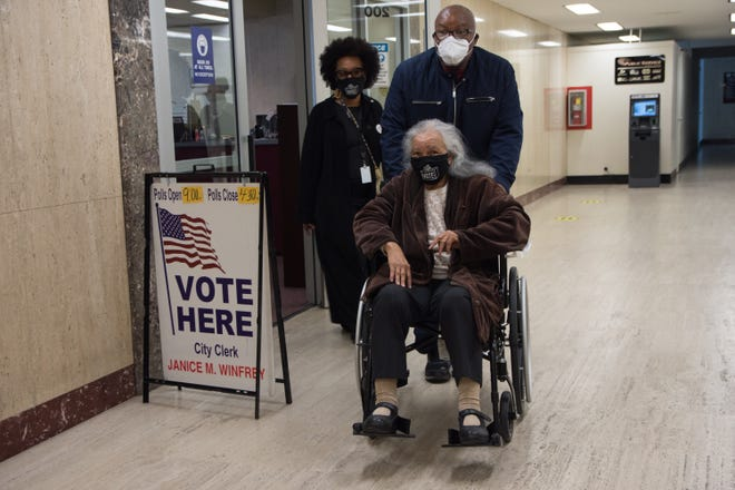 Detroiter Mildred R. Madison, 94, with her children Sharon Madison and Julian Madison, Tuesday at the Coleman A. Young Municipal Center. Madison has voted in 71 elections.