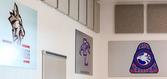 Harns Marsh Middle School has decked out its cafeteria with high school swag, trying to get kids thinking about their future. The school is the district's only middle school with a career specialist on staff. Signs for South Fort Myers, Cypress Lake High School, and Cape Coral High Schools signs hang in a corner.