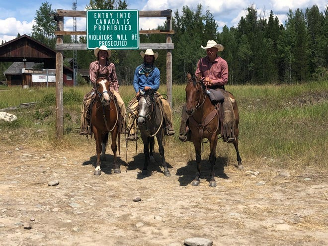 Keagan Stroop, Harry Green and Troy Hennes at the Montana-Canada border north of northwestern Montana's Polebridge on July 31, the day they completed a 600-mile journey across the wilderness in which they raised more than $30,000 for cancer care and research.