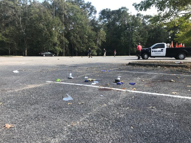Lafayette Police investigate the scene of a shooting that broke out in Moore Park that killed two Lafayette teens and injured two others on Oct. 14, 2020. The shooting was the result of a fight that started at a large party held at the park following the University of Louisiana at Lafayette football game.