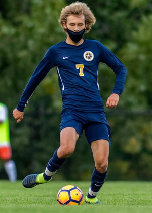 Hartland's John Chase scored the winning goal in a 3-2 shootout victory over Walled Lake Northern in a first-round district soccer game.