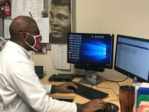 Dr. Christopher Jones, a transplant surgeon with University of Louisville Health, works in his office at U of L's Trager Transplant Center in Louisville, Ky.