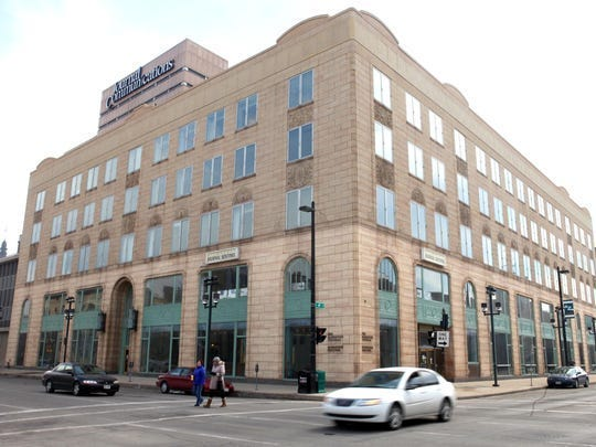 The $58 million redevelopment of the former Journal Sentinel buildings into housing is getting two public loans totaling $1.7 million.