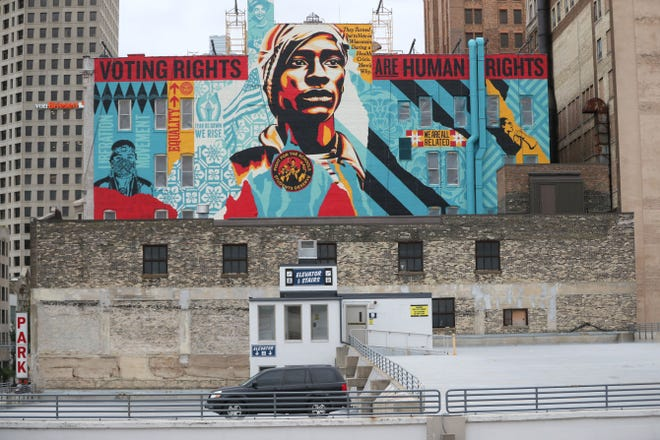 """Artist Shepard Fairey, creator of the Barack Obama """"Hope"""" poster, has painted a mural on a downtown Milwaukee building.  The mural, titled """"Voting Rights Are Human Rights,"""" is on the side of the Colby Abbot Building at 759 N. Milwaukee St."""