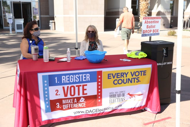 Two Doña Ana County Clerk document technicians, Patricia Triolo and Patti Scarborough, monitor the absentee ballot drop box location at the Doña Ana County Government Center on Wednesday, Oct. 14, 2020.