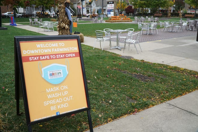 Tables and chairs await visitors to Farmington's Riley Park and its social district.