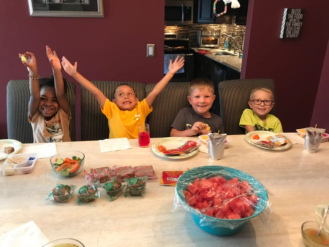 First-graders, from left, Zariah, Anthony, Brody and Brayden enjoying lunch during the school day.