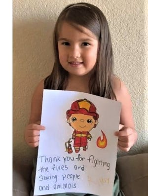 Riley, 5, of Phoenix wrote a thank-you letter to firefighters for National Thank You Letter Day.