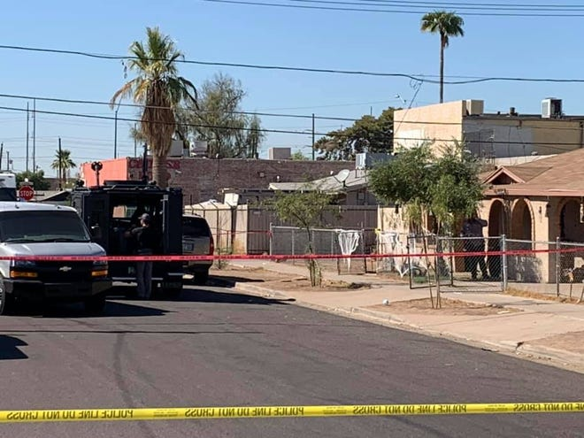 Officers negotiated with an armed suspect for hours before they say the man emerged from a Phoenix home with a gun on Oct. 15, 2020. An officer fired, but there were ultimately no injuries to the suspect or police at the scene.