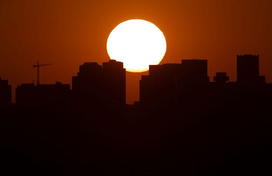 The sunset in Phoenix on Oct. 13, 2020, the 143rd day over 100 degrees in 2020. This tied a record from 1989.
