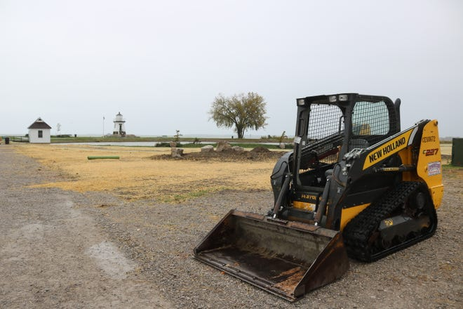 Crews will soon begin paving work for the new walkway around the Derby Pond at Waterworks Park after getting grass planted and covered this week before the rain hit Thursday.