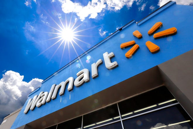 This June 25, 2019, file photo shows the entrance to a Walmart in Pittsburgh.
