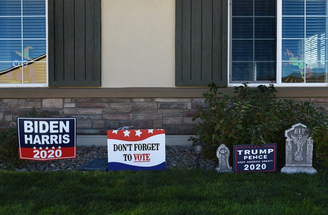Residents in a Spanish Springs neigborhood have a Biden and a Trump campaign sign on their front lawn. Oct. 15, 2020.
