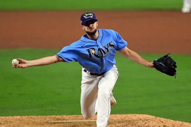 Oct 11, 2020; San Diego, California, USA; Tampa Bay Rays starting pitcher Ryan Thompson (81) pitching against the Houston Astros during the seventh inning in game one of the 2020 ALCS at Petco Park. Mandatory Credit: Jayne Kamin-Oncea-USA TODAY Sports