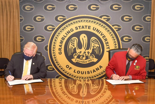 Bossier Parish Community College Chancellor Rick Bateman Jr. and Grambling State University President Rick Gallot signed a memorandum of understanding to let BPCC faculty and staff enroll at GSU at a reduced rate.