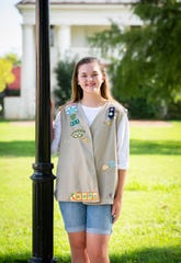 Maggie Majors is a Girl Scout and a Pendleton High School track team member.