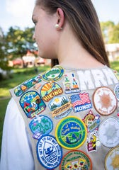 Maggie Majors who's her Girl Scout badges.