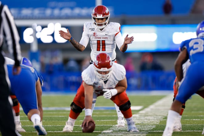 Oct 12, 2019; Colorado Springs, CO, USA; Fresno State Bulldogs quarterback Jorge Reyna (11) motions behind offensive lineman Matt Smith (59) in the second quarter against the Air Force Falcons at Falcon Stadium. Mandatory Credit: Isaiah J. Downing-USA TODAY Sports