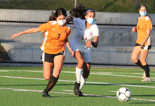 Mamaroneck's Jessica Bowman (7, left) fights for possession during a 3-1 win over New Rochelle on Oct. 14, 2020.