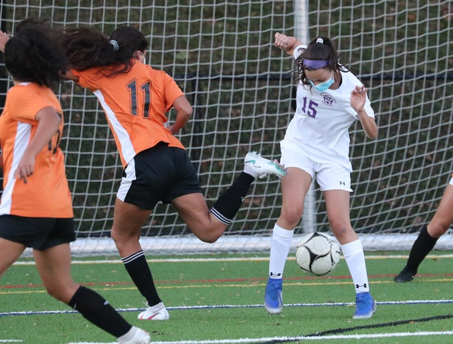 Mamaroneck's Mia Castaneda gets the ball past New Rochelle's Hailey Young during their game at Mamaroneck Oct. 14, 2020. New Rochelle won 3-1.