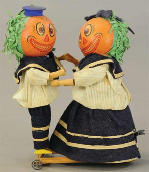 The pumpkin-head dancers are wearing their original blue felt and cotton sailor outfits. They are 8 1/2 inches tall and in excellent working condition, so a collector paid $1,920.