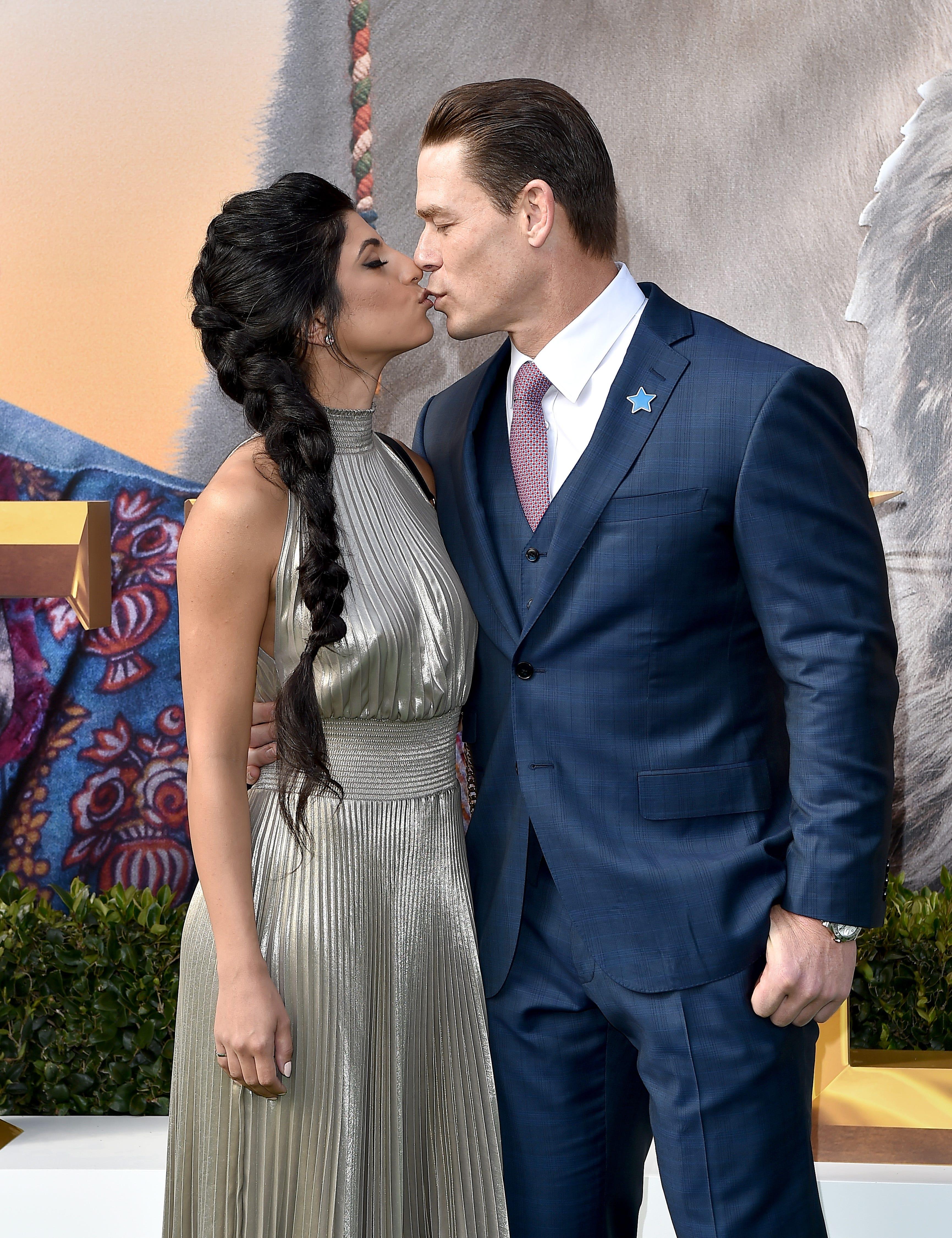 John Cena Reportedly Weds Shay Shariatzadeh In Quiet Florida Ceremony John cena with his wife. usa today