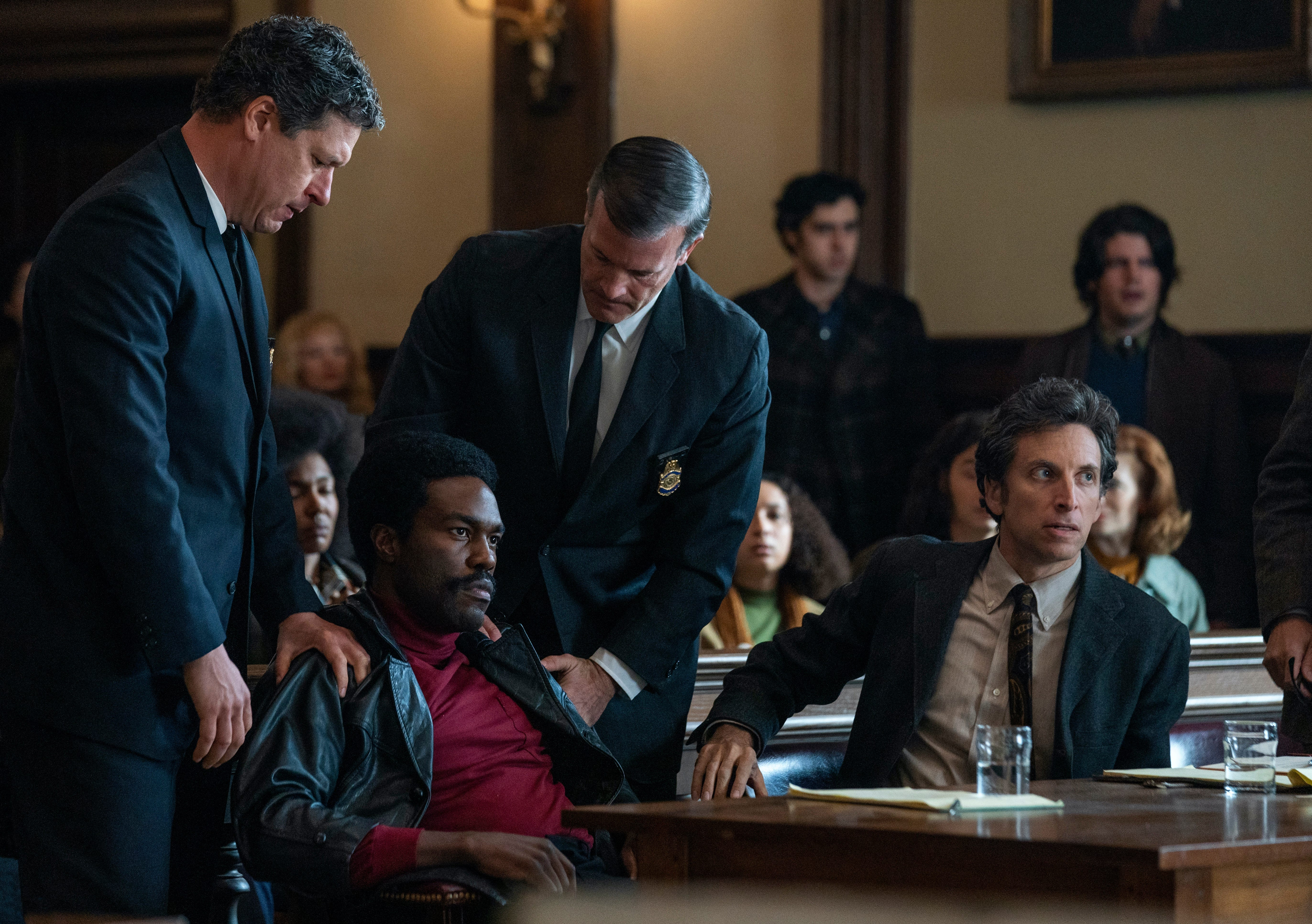 """Bobby Seale (Yahya Abdul-Mateen II, left) is roughed up by court marshals in """"The Trial of the Chicago 7."""""""