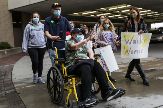 On Thursday morning, Oct. 15th, 2020, Deanna Hair is discharged from the University of Michigan hospital in Ann Arbor, Mich. with help from her husband, Ken Hair, who pushes her in a wheelchair after being there for 196 days battling COVID (She was admitted on April 2nd).