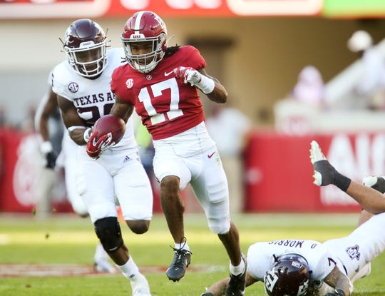 Alabama wide receiver Jaylen Waddle breaks free for a touchdown after catching a pass against Texas A&M at Bryant-Denny Stadium.