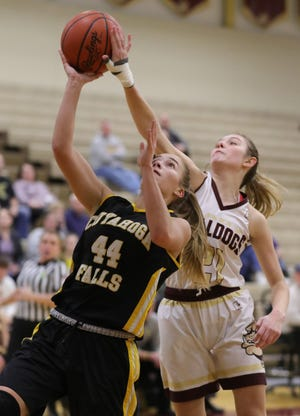 Cuyahoga Falls' Emma Brustoski is fouled by Stow's Lilee Carlson during a third-quarter layup in a game in 2019.