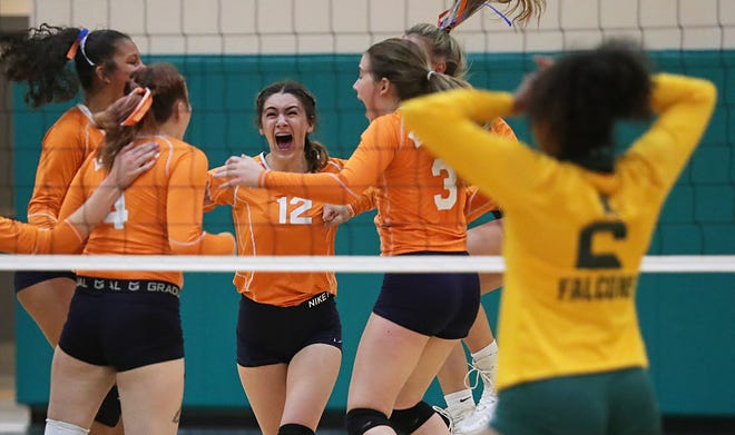 Ellet's Olivia Phillips, center, celebrates with teammates after defeating Firestone in five sets to win the City Series volleyball championship as Firestone's Savannah Diamond reacts at Firestone High School, Thursday, Oct. 15, 2020, in Akron, Ohio. [Jeff Lange/Beacon Journal]