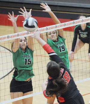 West Branch's Alexa Gossett (15) and Mikalyn Fitts jump to block a shot at the net by Salem's Kaley Davis in an Eastern Buckeye Conference match at Salem High School Thursday, October 15, 2020.