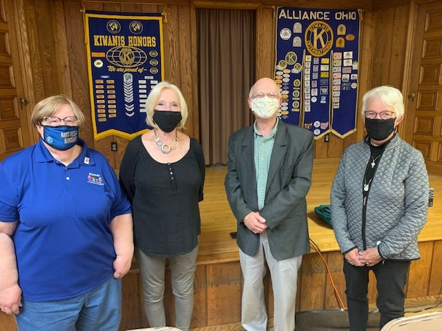 Alliance Kiwanis Club officers recently installed include, from left, Susan Denning as secretary; Pat Gates as president; Jim Perone as treasurer; and Lynda Slack as president elect.