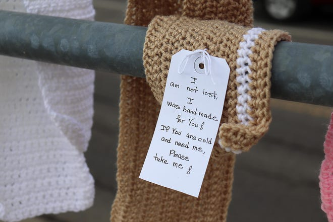 Tags are included on each scarf donated for the annual Scarf Project. This scarf from 2019 was affixed to a railing Friday at North Union Avenue and East Main Street in Alliance.
