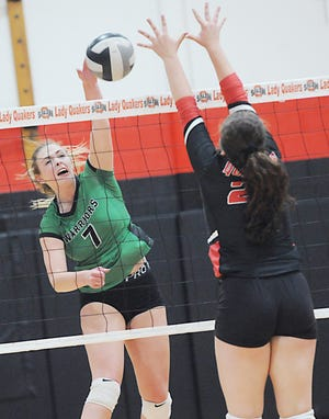 West Branch's Riley Tuel (7) goes for a kill at the net against Salem's Kaley Davis in an Eastern Buckeye Conference match in October 2020. Tuel was named Eastern Buckeye Conference volleyball Player of the Year.