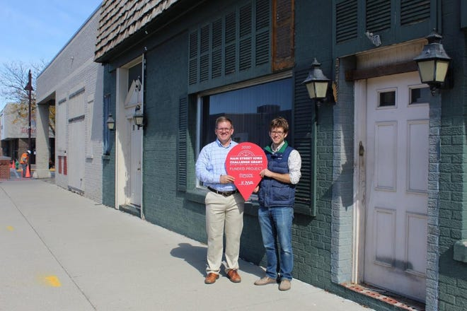 Chris Nelson, left, and Matt Nelson pose for a photo outside the buildings at 330 5th St. and 412 Burnett Ave., which recently received a $75,000 Main Street Iowa Challenge Grant.